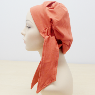 Rust Modern Beret - side view (worn without the loose patterned scarf)